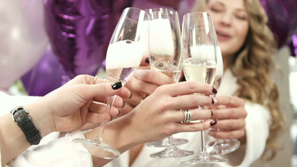 videoblocks close up view of girls opening champagne bottle drinking champagne at the party rz8ksdofnx thumbnail full01