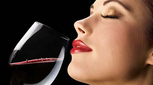 happy-woman-drinking-wine